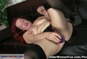 Redhead bitch with big boobs plays with a hairy pussy